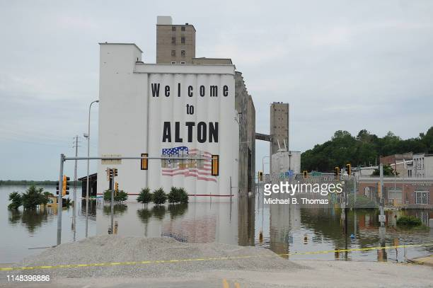 Floodwaters are seen along a submerged road on June 6 2019 in Alton Illinois Residents along the Mississippi River are bracing for the expected...