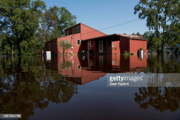 Floodwaters caused by Hurricane Florence rise in front of a home near the Crabtree Swamp on September 21, 2018 in Conway, South Carolina. The...