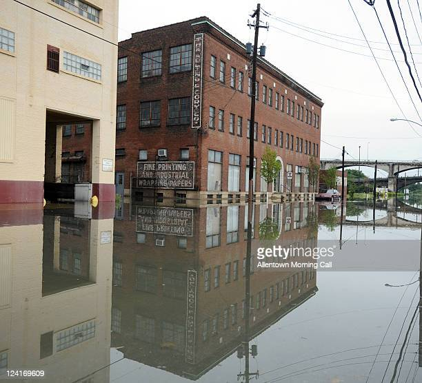 Floodwaters cover a part of 10th Street off of Market Street as the Susquehanna River swells in Harrisburg Pennsylvania after heavy rain on Thursday...