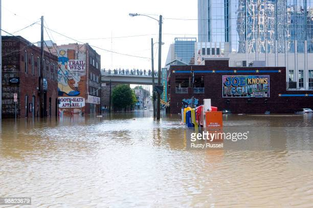Floodwaters cover downtown streets and sidewalks May 3 2010 in the Lower Broad district of Nashville Tennessee More than 13 inches of rain fell over...