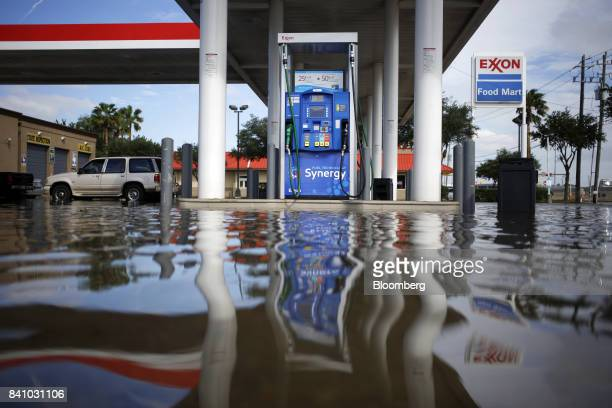 Floodwaters from Hurricane Harvey surround a fuel pump at an Exxon Mobil Corp gas station in Houston Texas US on Wednesday Aug 30 2017 Unprecedented...