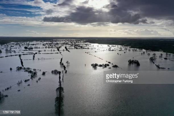Floodwaters from the River Dee cover fields near Farndon, Cheshire, in the aftermath of Storm Christoph on January 22, 2021 in Farndon, England. At...