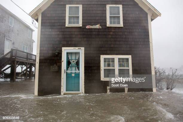 Floodwaters near the entrace to a home on Lighthouse Rd during a large coastal storm on March 2 2018 in Scituate Massachusetts A nor'easter is set to...
