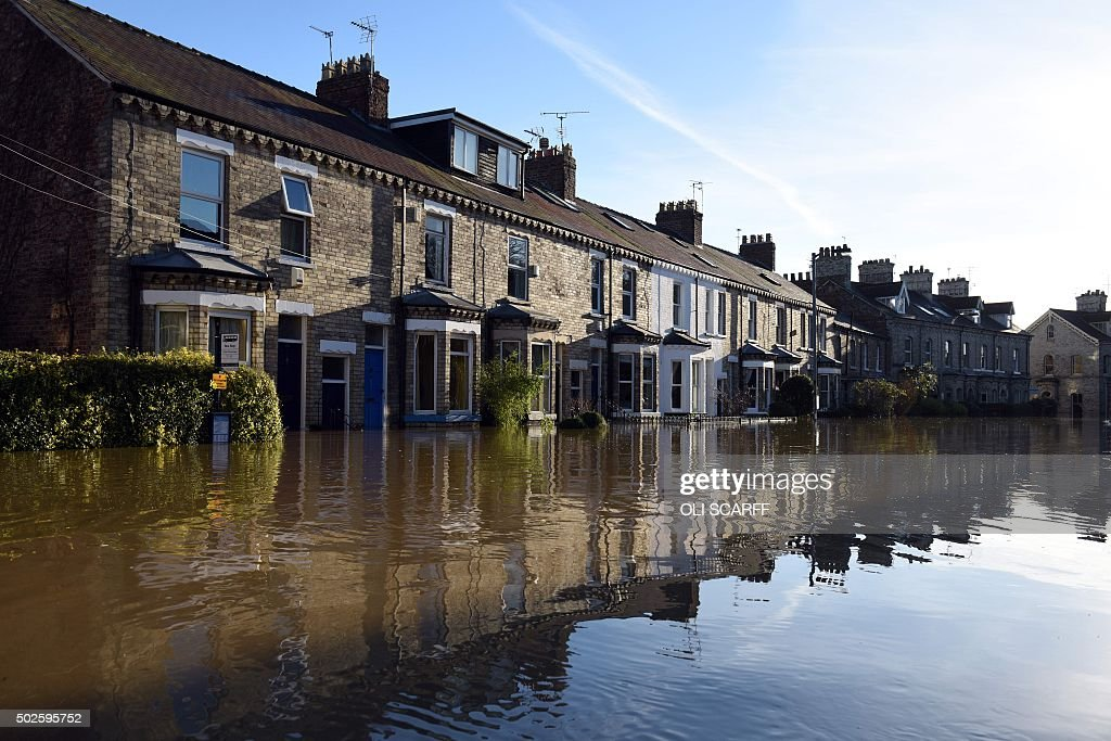 Floodwaters on Huntington Road are pictured, after the adjacent River Foss burst it's banks in York, northern England, on December 27, 2015