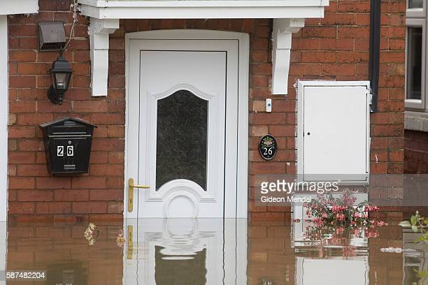 Floodwaters reach halfway up a front door on one of the flooded streets in Catcliffe Village This was one of the communities flooded when a freak...