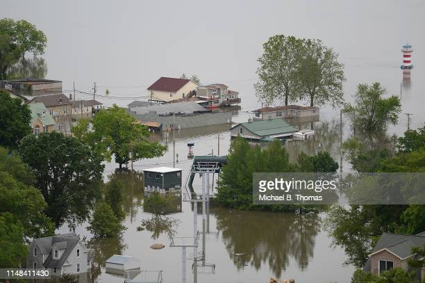 Floodwaters submerge a residential area on June 6 2019 in Grafton Illinois Residents along Mississippi river are bracing for the expected arrival of...