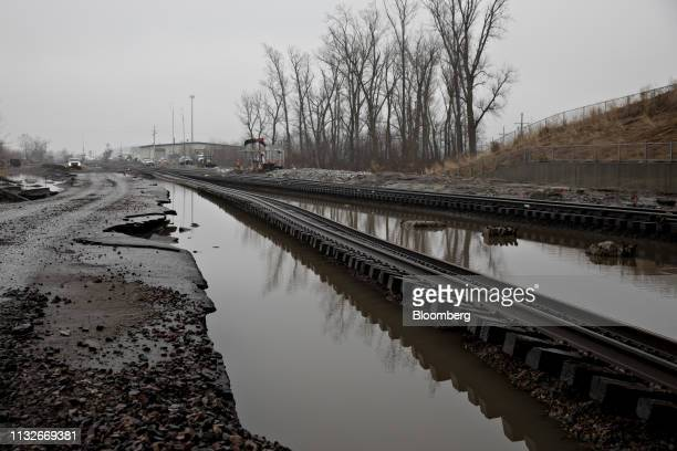 Floodwaters surround a damaged section of a Burlington Northern Santa Fe LLC train tracks in Plattsmouth Nebraska US on Sunday March 24 2019 The...