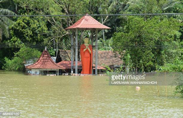 Floodwaters surround a temple in Bulathsinhala in Sri Lanka's Kalutara district on May 27 2017 Rainfall on May 26 triggered the worst flooding and...