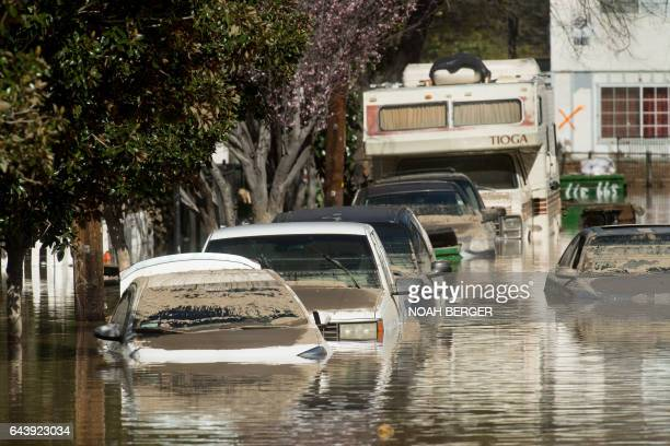 Floodwaters surround homes and cars on February 22 in San Jose California Thousands of people were ordered to evacuate their homes early Wednesday in...