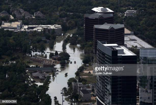 Floodwaters surround office buildings on September 5 2017 in Houston Texas Over a week after Hurricane Harvey hit Southern Texas residents are...