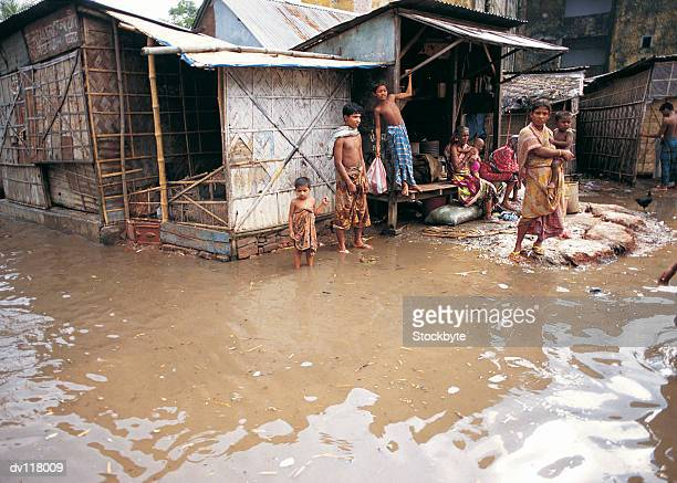 floodwaters surrounding houses in dhaka,bangladesh - bangladesh stock pictures, royalty-free photos & images
