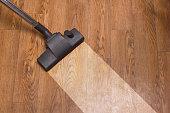floor cleaning of linoleum with vacuum cleaner