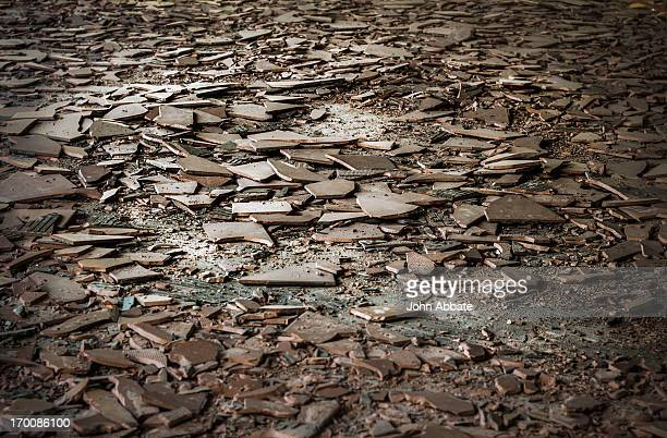 Floor covered in broken tiles and rubble