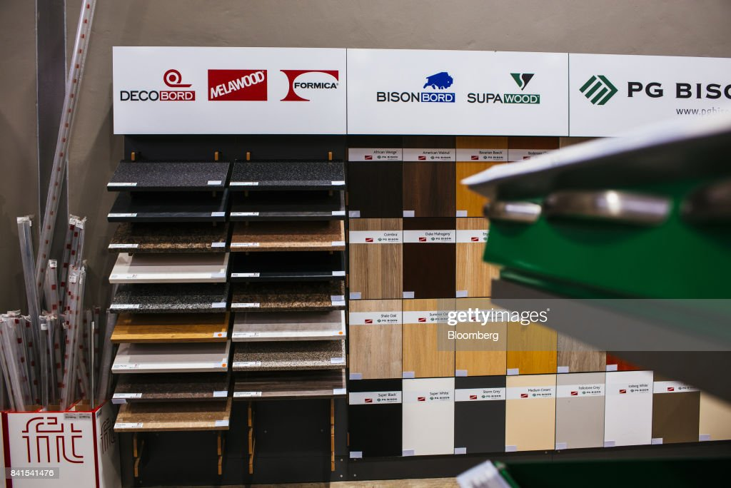 Floor coverings and work surface samples from manufacturers including Decobord, Melawood, Formica, Bisonbord and Supawood, manufactured by PG Bison Southern Cape Ltd., sit on display inside a Timbercity store, operated by Steinhoff International Holdings NV, in Johannesburg, South Africa, on Thursday, Aug. 31, 2017. Steinhoff said like-for-like sales rose 8 percent as the South African furniture and clothing retailer achieved gains in its core European and African markets. Photographer: Waldo Swiegers/Bloomberg via Getty Images