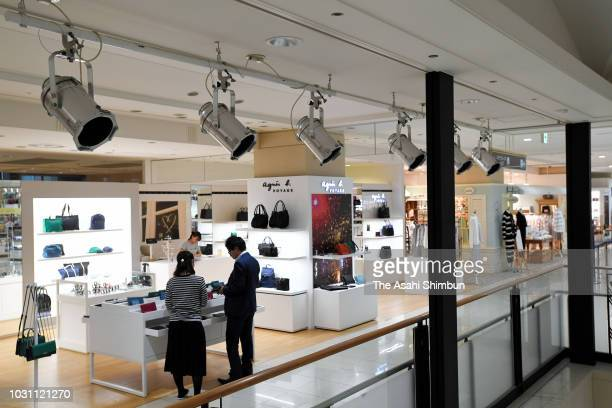 A floor is partially turned off in attempt to save energy at a department store on September 10 2018 in Sapporo Hokkaido Japan Commuters hit the...