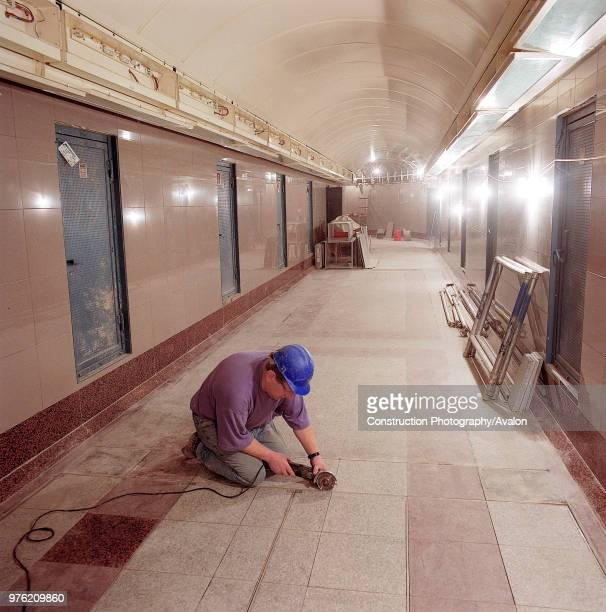 Flooring works in passenger tunnel during refurbishment of Angel Underground station London United Kingdom