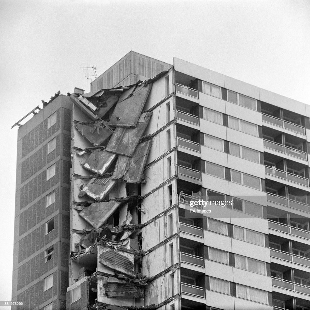 Floors and ceilings hang down a corner of a Canning Town flat block following their collapse, in which 4 people died.
