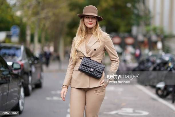 Floortje Van Cooten wears a blazer jacket camel pants a hat a chanel bag outside Andrew GN during Paris Fashion Week Womenswear Spring/Summer 2018 on...