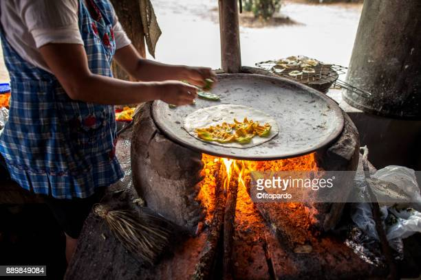 flor de calabaza quesadilla being made in a comal - oaxaca stock pictures, royalty-free photos & images