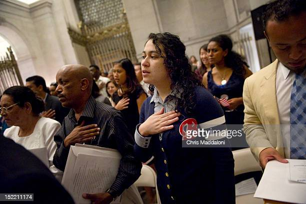 Flor Silva from El Salvador is swornin at a naturalization ceremony for 225 petitioners seeking US citizenship at the National Archives The ceremony...