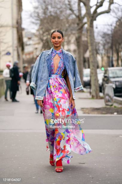 Flora Coquerel, Miss Orleanais 2013 and Miss France 2014, wears a blue denim jacket, a colorful pink and blue floral print dress with a keyhole, red...