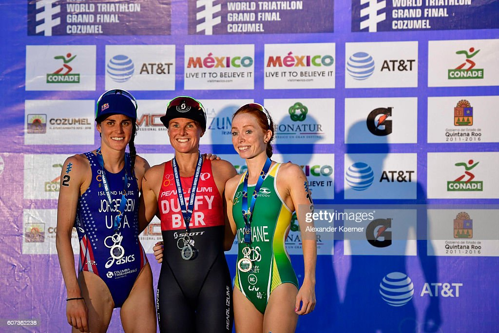Flora Duffy of Bermuda (c) first place, Gwen Jorgensen of United States second place and Charlotte McShane of Australia third place, line up after the Woman Elite ITU World Championship race at the Fonatur Triathlon Park on September 17, 2016 in Cozumel, Mexico. The ITU Grand Final World Championship will be held until Sunday.