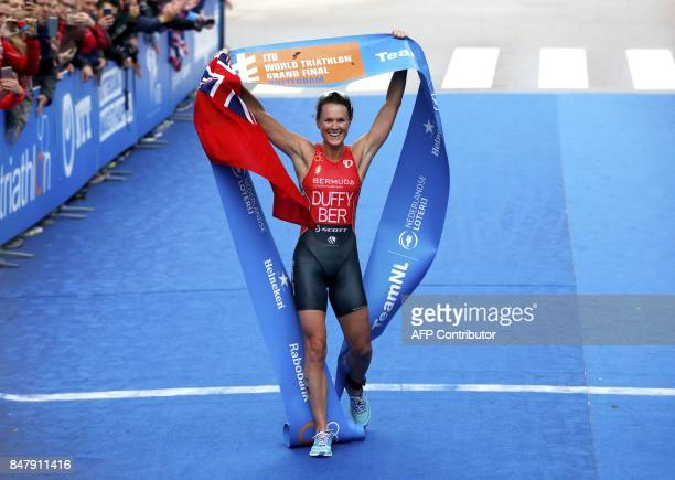 Flora Duffy of Bermuda reacts while crossing the finish line to win the World Triathlon Grand Final in Rotterdam on September 2017 / AFP PHOTO / ANP...