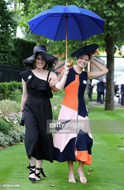 Flora Macdonald Johnston and Milja Kljajic arrive in the rain at Royal Ascot 2016 at Ascot Racecourse on June 14 2016 in Ascot England