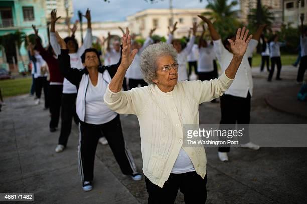Flora Medina lifts her arms in a TaiChi motion during a circulo de abuelos in Villalon Park located in the neighborhood of Verdado in Havana Cuba She...