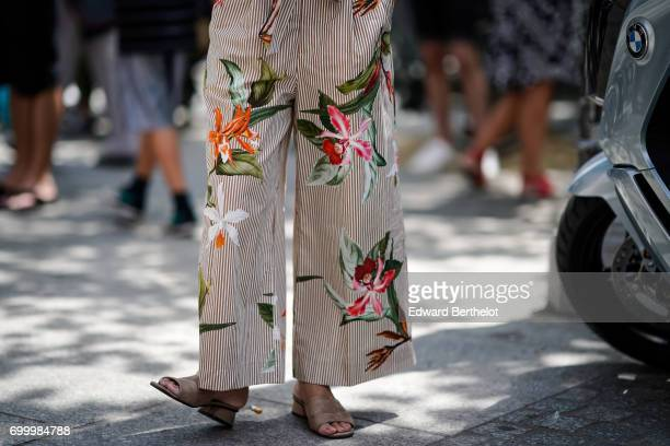 Flora print pants are seen outside the Louis Vuitton show during Paris Fashion Week Menswear Spring/Summer 2018 on June 22 2017 in Paris France