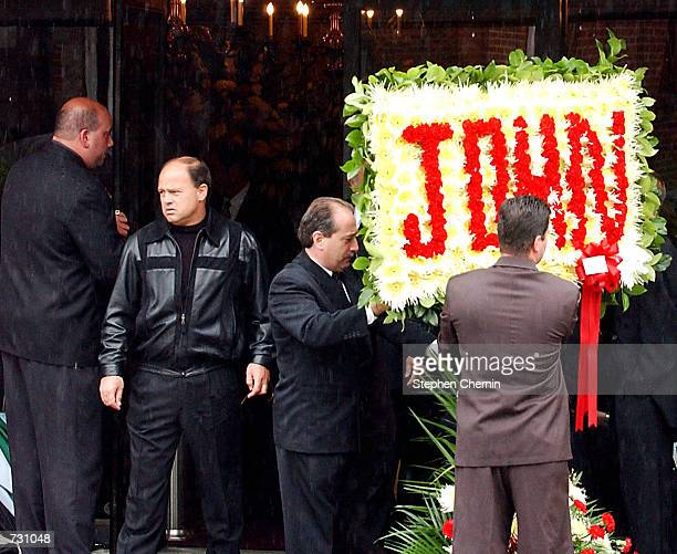 A floral arrangement with the name John spelled in flowers is placed in front of the Papavero funeral home for the wake of the late mobster John...