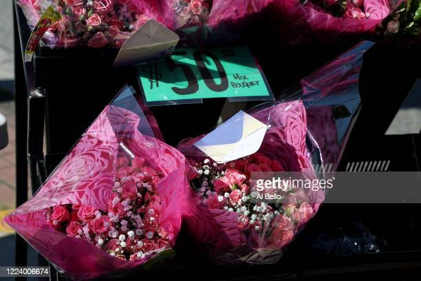 Floral arrangements are placed outside the Flowers by Voegler store on May 10 2020 in Merrick New York Theresa Soto is the owner of Flowers by...