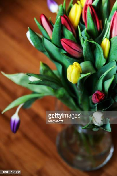 floral background bouquet multicolored tulips glass