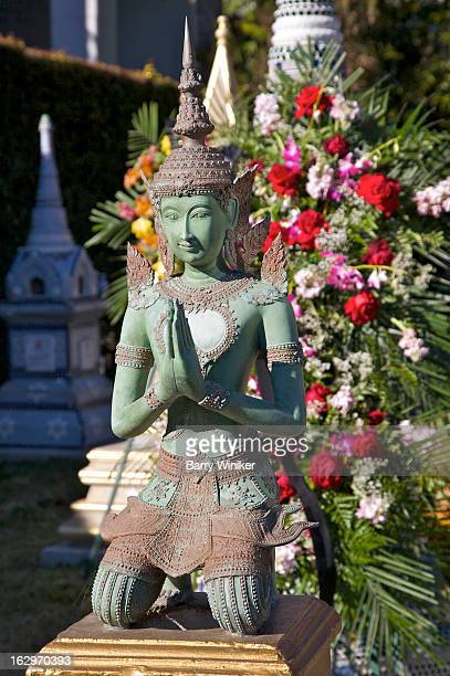 Floral bouquet on buddha.