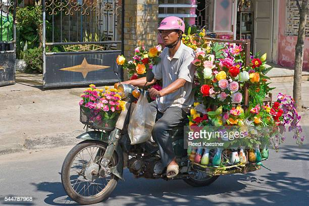 A floral delivery service uses a motor bike in Hoi An, Vietnam