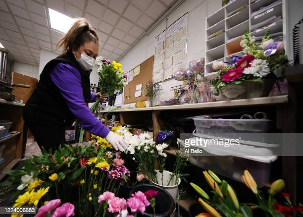 Floral Designer Maura Solorzano prepares floral arrangements inside the Flowers by Voegler store on May 10 2020 in Merrick New York Theresa Soto is...