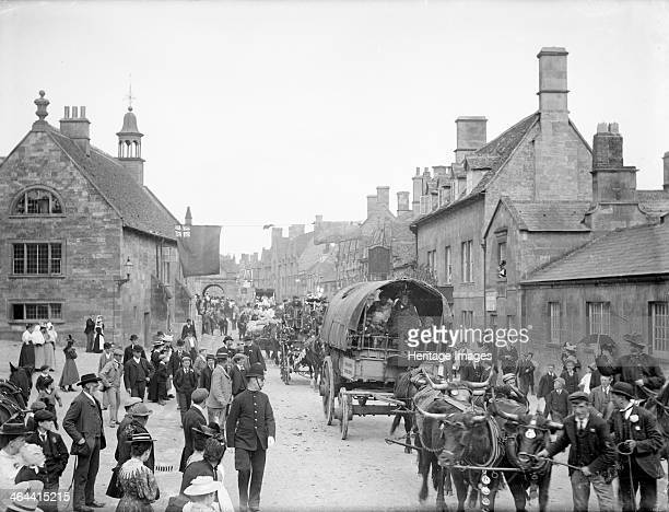 Floral Festival Chipping Campden Gloucestershire 1897 The procession at the town's floral festival with the Jameson Cart in the foreground drawn by...