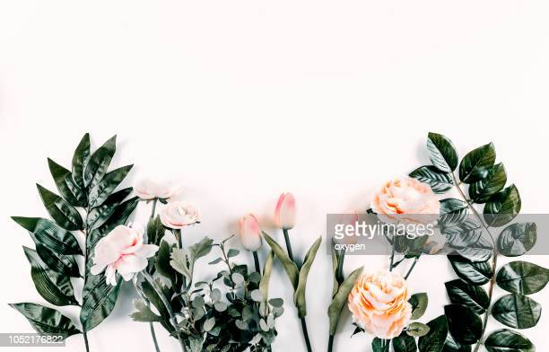 floral pattern on white background. flat lay, top view - motivo floreale foto e immagini stock