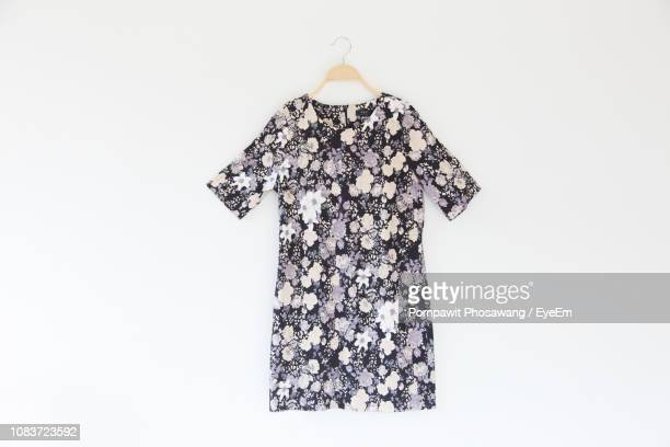 floral patterned dress against white background - dress stock pictures, royalty-free photos & images