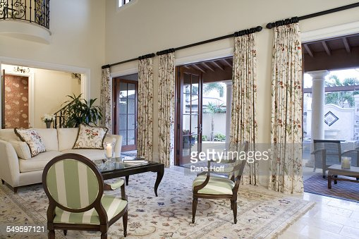 Floral rug and curtains in white living room with high for High ceiling curtains