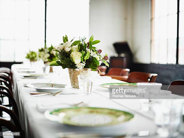 Floral setting on table set for dinner in loft