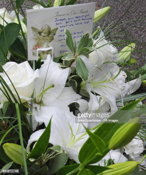 A floral tribute for Joseph Lappin from his parents outside church at his funeral service at St Oswald's Church Old Swan Liverpool