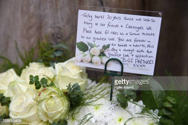 Floral tribute from BCG Partners laid at the September 11 Memorial Garden at Grosvenor Square on September 11, 2021 in London, England. People across...