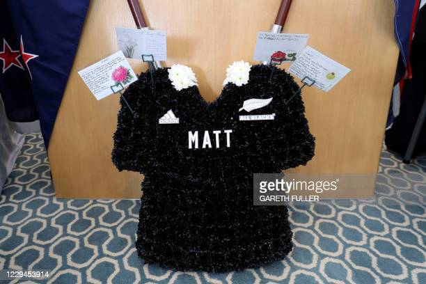 Floral tribute in the shape of an All Blacks rugby shirt sits by the coffin of New Zealand-born Metropolitan Police officer Sergeant Matt Ratana...