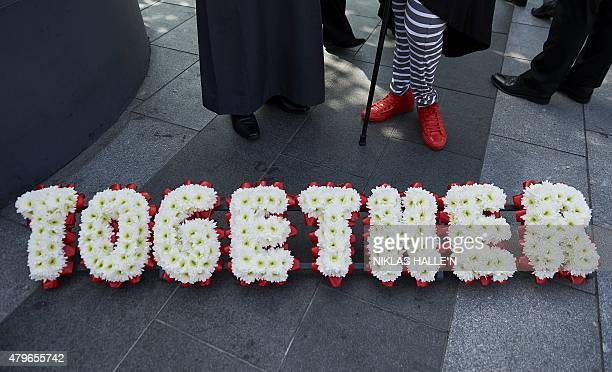 A floral tribute is pictured during an event held by faith leaders to promote religious unity in central London on July 6 as Britain prepares to mark...