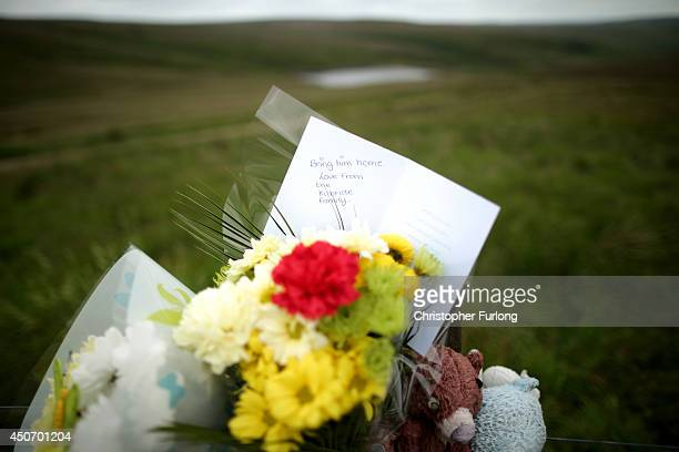 A floral tribute to Keith Bennett from the family of moors murder victim John Kilbride overlooks Saddleworth Moor where the body of missing Keith...
