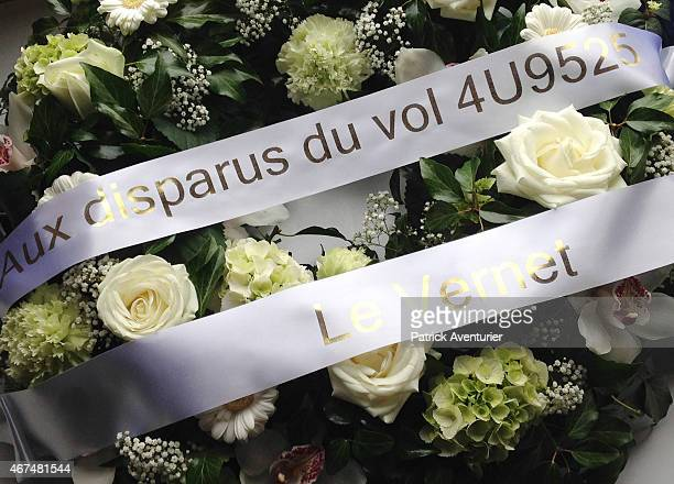 A floral tribute to the victims near the site of the Germanwings plane crash in the French Alps on March 25 2015 in Vernet France A Germanwings...
