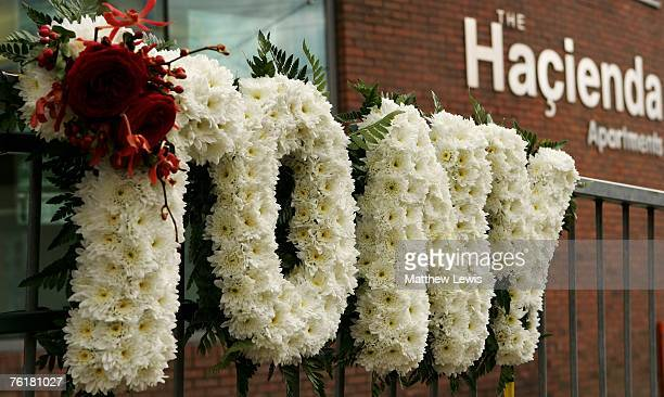 Floral tribute to Tony Wilson is left on the railings outside the Hacienda Apartments which was a club that Tony managed on August 20 2007 in...