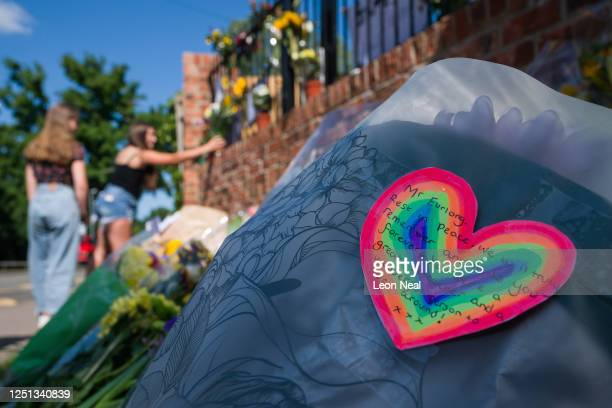 Floral tribute with a rainbow message is seen as a student lays flowers and pays respect to the murdered school teacher James Furlong outside The...