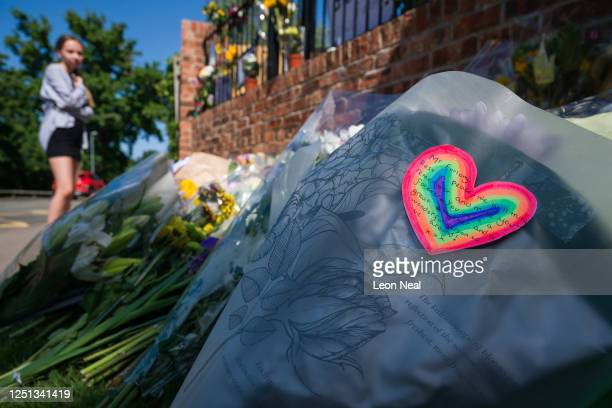 A floral tribute with a rainbow message is seen as a student pays respect to the murdered school teacher James Furlong outside The Holt School on...